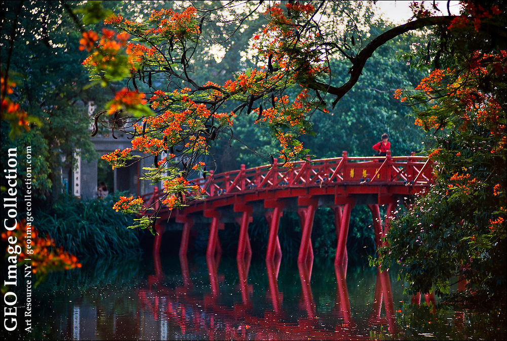 Tamarind blossoms frame a bridge to the Tortoise Tower at the Lake of the Restored Sword in Hanoi. The foundation of the tower dates to the late nineteenth century, when a Vietnamese bureaucrat working for the French colonial government received permission to build a shrine to Le Loi, who led the Vietnamese people to victory against the Ming dynasty in the fifteenth century.