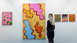 © Licensed to London News Pictures. 15/01/2019. LONDON, UK. A staff member views a selection of works by Michael Roberts (2017) at the Patrick Heide Contemporary Art stand.  Preview of London Art Fair 2019 at the Business Design Centre in Islington.  The annual fair showcases exceptional modern and contemporary art from the 20th century to present day and opens 16 to 20 January.  Photo credit: Stephen Chung/LNP
