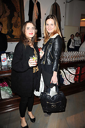 Left to right, FLORA PARKINSON and GRACE HUDSON-EVANS at reception to raise funds for a Ugandan School Project supported by the Henry van Straubenzee Memorial Fund held at Few & Far, 242 Brompton Road, London SW3 on 11th February 2010.