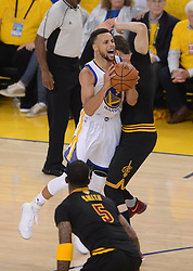The Golden State Warriors' Stephen Curry (30) is fouled by the Cleveland Cavaliers' Kyle Korver (26) in the first quarter of Game 5 of the NBA Finals at Oracle Arena in Oakland, Calif., on Monday, June 12, 2017. (Photo by Dan Honda/Bay Area News Group/TNS) *** Please Use Credit from Credit Field ***