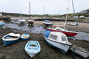 Boats sit in the sand and mud in the empty harbour with the tide out on 15th September 2020 in Cemaes Bay, Anglesey, Wales, United Kingdom. Cemaes is a village on the north coast of Anglesey in Wales, sited on Cemaes Bay, an Area of Outstanding Natural Beauty which is partly owned by the National Trust. It is the most northerly village in Wales. The name Cemaes derives from the Welsh word cemais, meaning 'bend or loop in a river, inlet of sea, bay'.