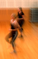 PARIS, FRANCE - APRIL-21-2004 - University students exercise in an aerobics class at a health club. Exercise - sport - physical fitness - training  - workout - running - weight lifting - gym - health club - aerobics - female - women - movement - motion - blur (PHOTO © JOCK FISTICK)