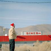 A man in a Santa hat in the Californian desert near Los Angeles, USA