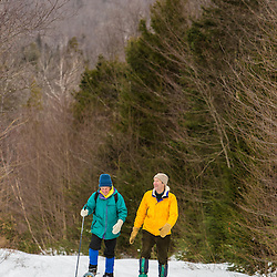 A couple snowshoeing in Vermont's Green Mountains. Shrewsbury, Vermont.  Jim Jeffords State Forest.