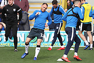 Gillingham defender Barry Fuller (12) warming up during the EFL Sky Bet League 1 match between AFC Wimbledon and Gillingham at the Cherry Red Records Stadium, Kingston, England on 23 March 2019.