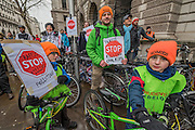 A whole family joins the protest - Stop Killing Cyclists stage a die-in to remember Anita Szucs, 30 and Karla Roman, 32 (both killed while cycling on Monday), and Ben Wales, 32. They are demanding investment in cycling and walking in the hope that it rises to 10% of the UK transport budget by the end of this parliament. They also point out that air pollution is poisoning millions of people in the UK and road danger means most people do not feel safe cycling on UK roads - meaning they miss out on healthy exercise and compounding a health disaster which the NHS will struggle to afford. They met outside the National Gallery and moved to the Treasury, Horse Guards Parade for protest.