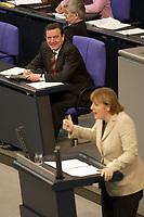 19 DEC 2003, BERLIN/GERMANY:<br /> Gerhard Schroeder (L), SPD, Bundeskanzler, und Angela Merkel (R), CDU Bundesvorsitzende, waehrend ihrer Rede,  Sondersitzung des Bundestages zur Abstimmung ueber das Reformpaket zu Steuern und Arbeitsmarkt, Plenum, Deutscher Bundestag<br /> IMAGE: 20031219-01-041<br /> KEYWORDS: Gerhard Schröder, speech