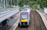 British Rail Class 755 Stadler bi-modal train leaving railway station at Woodbridge, Suffolk, England, UK destination Ipswich