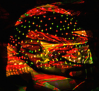 surreal jelly fish, covered by many multicolored lights and transparencies on dark background