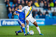 Gillingham FC defender Barry Fuller (12) and Oxford United forward Tariqe Fosu-Henry (11)during the EFL Sky Bet League 1 match between Gillingham and Oxford United at the MEMS Priestfield Stadium, Gillingham, England on 18 January 2020.