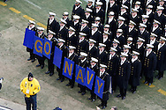 """6 Dec 2008: Navy Midshipman hold a """"Go Navy"""" sign on the field before the Army / Navy game December 6th, 2008. At Lincoln Financial Field in Philadelphia, Pennsylvania."""