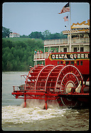 Delta Queen's paddlewheel churns down Mississippi past historic, bluff-top Weymouth Hall; Natchez Mississippi