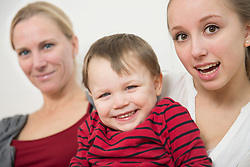 Portrait of family smiling, close up