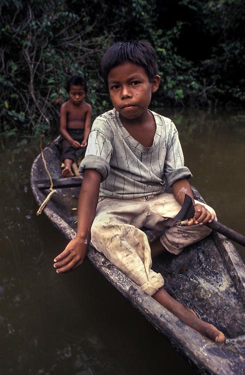 Boys fishing from their canoe, near Leticia, Amzaonas