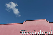 A single fluffy cloud in blue sky passes over Wonderland, a former nightclub in Sutton south London, on 2nd October 2019, in Sutton, London, England.