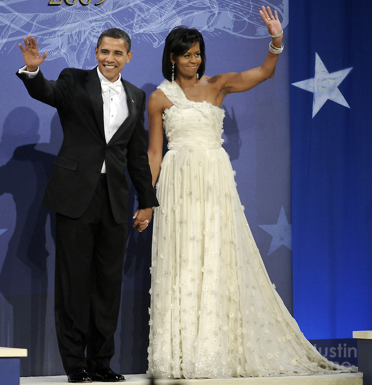 President Barack Obama (L) and first lady Michelle Obama wave as thew arrive to the Biden Home States Ball at the Washington Convention Center in Washington, DC, USA 20 January 2009. The ball is one of many Obama will attend over the course of the night, several hours after being sworn in as the 44th President of the United States.Barack H. Obama is sworn in as the 44th President of the United States during the 56th Presidential Inauguration ceremony on the steps of the U.S. Capitol Building in Washington, D.C., USA 20 January 2009. Obama defeated Republican candidate John McCain on Election Day 06 November 2008 to become the next U.S. President.