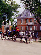 Horses with carraige passing the Governor's Palace at Colonial Williamsburg, the restored eitheenth-century capital of Virginia.
