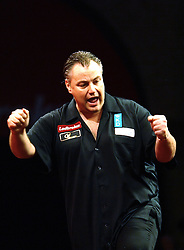 Canada's John Part celebrates beating Wales's Richie Burnett 4-1 to move to the next round in the Darts World Championships at Alexandra Palace, London, Tuesday, Dec.. 27, 2011. photo by morn/I-Images