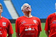 Tommy Charlton of England over 60's looks up at the sky during the line-up before the world's first Walking Football International match between England and Italy at the American Express Community Stadium, Brighton and Hove, England on 13 May 2018. Picture by Graham Hunt.