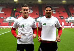 Joe Bryan and Korey Smith of Bristol City show off their shirts supporting Children's Hospice South West - Mandatory by-line: Paul Knight/JMP - 04/03/2017 - FOOTBALL - Ashton Gate - Bristol, England - Bristol City v Burton Albion - Sky Bet Championship