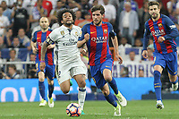 Sergi Roberto of FC Barcelona holds off pressure from  Marcelo Vieira of Real Madrid during the match of La Liga between Real Madrid and Futbol Club Barcelona at Santiago Bernabeu Stadium  in Madrid, Spain. April 23, 2017. (ALTERPHOTOS)