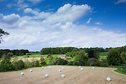 English countryside with chapel in a field, St Oswald's, in The Cotswolds, Oxfordshire
