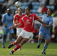 Photo: Lee Earle.<br /> Coventry City v Barnsley. Coca Cola Championship. 17/03/2007.Coventry's Michael Mifsud(R) battles with Lewin Nyatanga.