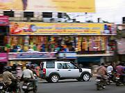 A 4x4 vehicle driving along busy street, Cochin, Kerala, India