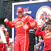 Regan Smith celebrates his victory after winning the NASCAR DRIVE4COPD 300 auto race at Daytona International Speedway on Saturday, February 22, 2014 in Daytona Beach, Florida.  (AP Photo/Alex Menendez)