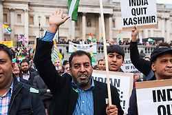 Trafalgar Square, London, October 26th 2014. Thousands of Kashmiris in London demonstrate in Trafalgar Square before marching to Downing Street to deliver a petition asking for Britain's support in ending the occupation of Kashmir by India.