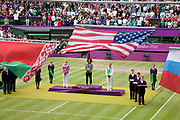 Crowds watch in Centre Court as the Tennis events at the London 2012 Olympics take place at Wimbledon. Serena Williams receives her gold medal during the medal ceremony.
