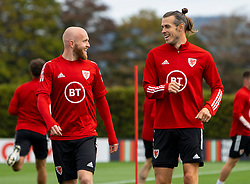 CARDIFF, WALES - Saturday, September 5, 2020: Wales' Jonathan Williams (L) and captain Gareth Bale during a training session at the Vale Resort ahead of the UEFA Nations League Group Stage League B Group 4 match between Wales and Bulgaria. (Pic by David Rawcliffe/Propaganda)