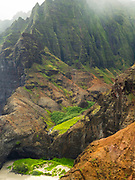 Aerial view of Kalalau Beach and the Na Pali coast, Kauai, Hawaii on a cloudy day.