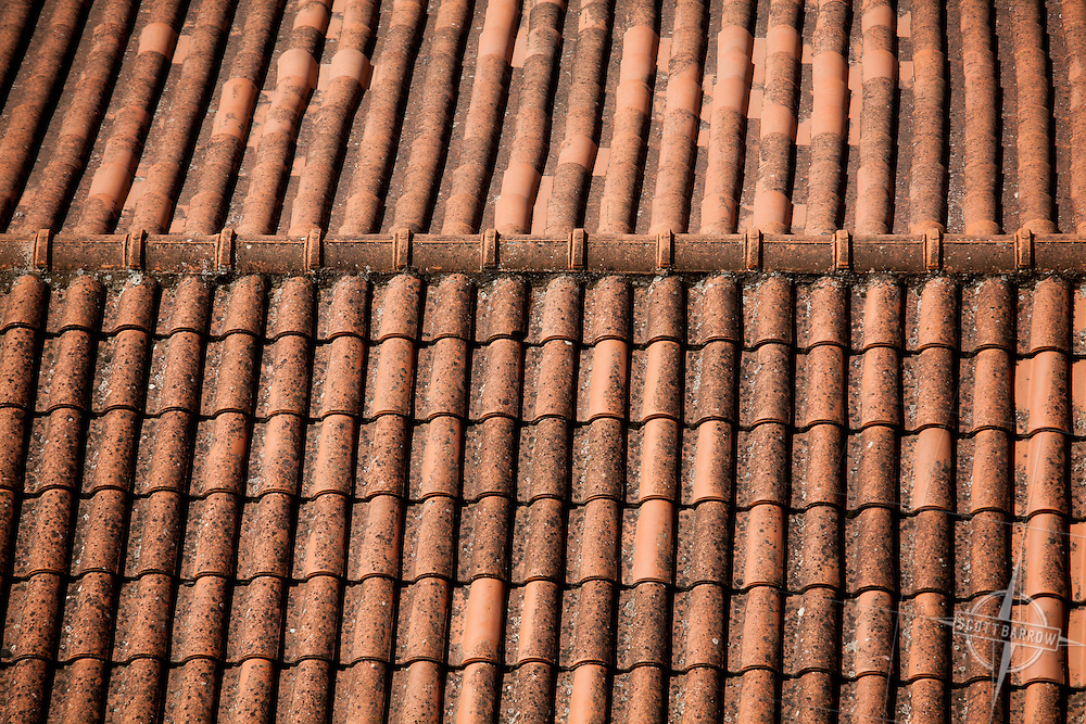 Terracotta tiled roof in Italy .
