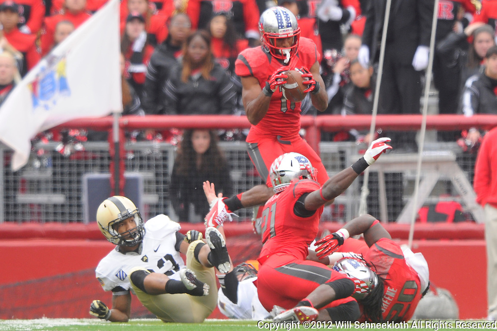 10 November 2012: Rutgers Scarlet Knights defensive back Logan Ryan (11) catches a fumble popped into the air during NCAA college football action between the Rutgers Scarlet Knights and Army Black Knights at High Point Solutions Stadium in Piscataway, N.J..