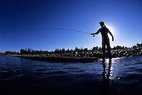 A woman fishes the Snake River in Grand Teton National Park, Jackson Hole, Wyoming.