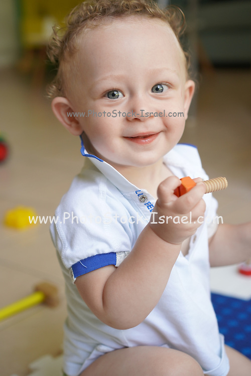 Young playful toddler boy