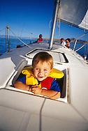 Family sailing on Great Salt Lake, Utah.