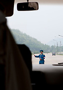 HIGHWAY TO YELL IN NORTH KOREA<br /><br />Taking the highways in North Korea is a great experience as it allows to see the daily life of the country not controled by the government like in Pyongyang. They connect the main towns of the countries and are totally empty of cars. It makes a very strange atmosphere as the roads are as large as airstrips, but in bad shapes with lot of bumpings and holes.<br />Everything is planned when you travel in North Korea, even the bathrooms stops, as according to the guide, it is too dangerous to stop on the highway to make a pee stop!<br />Some shops in the middle of nowhere welcome you for a relaxing moment where one more time, you'll be able to read some propaganda on the walls. It will also allow your driver to buy cheap Soju (rice alcool) that they drink like Red Bulls but with different side effects!<br /><br />Photo Shows:  There are no tolls in North Korea, but you cannot leave Pyongyang without a special authorization. Even for local people. The lack of public transporation is reducing the risk of escapes...<br />©Eric Lafforgue/Exclusivepix Media