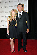 Mac Davis (right) and Cheyenne Kimball posing before entering the 37th Annual Songwriters Hall of Fame Induction Ceremony at the Marriott Marquis Hotel in New York, USA, on Thursday, June 15, 2006. **ITALY OUT**