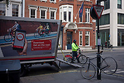 A TFL Santander bike engineer and a scene of bikes, on 11th January 2017, in Mayfair, London, England. Santander Cycles formerly Barclays Cycle Hire is a public bicycle hire scheme in London, United Kingdom. The schemes bicycles are popularly known as Boris Bikes, after Boris Johnson, who was the Mayor of London when the scheme was launched. The operation of the scheme is contracted by Transport for London to Serco and the record for cycle hires in a single day is 73,000.