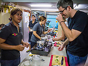 """29 MARCH 2013 - BANGKOK, THAILAND: Saiyuud Diwong """"Poo"""" works with student/reporter Kent Annan in her cooking school.    PHOTO BY JACK KURTZ"""