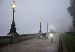 © Licensed to London News Pictures. 05/11/2020. London, UK. A e-scooter rider makes his way along the embankment of the River Thames in fog near Lambeth Bridge in central London on the first day of England's national lockdown. Photo credit: London News Pictures
