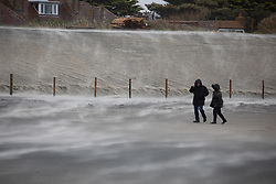 © Licensed to London News Pictures. 04/10/2020. Wittering, UK. Walkers are battered by strong winds at West Wittering Beach caused by Storm Alex. The storm has brought strong winds and heavy rain. Photo credit : Tom Nicholson/LNP