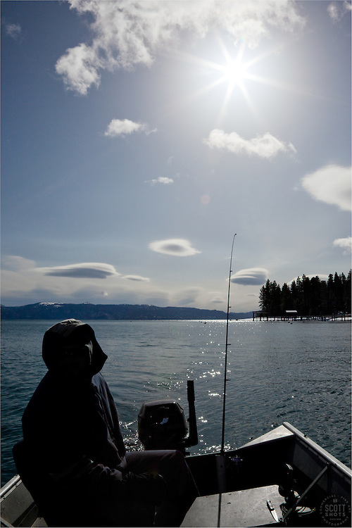"""Fishing on Lake Tahoe"" - This fisherman on Lake Tahoe ended up catching a Mackinaw this day."