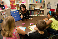 Senior teaching and learning major Katherine Folse with the Santa Rosa Tutor Mentor Program works with second graders Madison Freeman, Christian Justice and Mariah Rugg at East Milton Elementary School Thursday April 21, 2016 in Milton, Florida. (Michael Spooneybarger/ CREO)