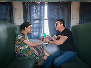 A recently married couple. Life inside the train - mostly Muslim Uighur people  ride this train.