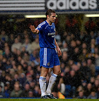 Photo: Ed Godden.<br />Chelsea v Fulham. The Barclays Premiership. 30/12/2006.<br />Chelsea's Frank Lampard stands in the torrential rain.
