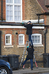© Licensed to London News Pictures. 04/02/2018. London, UK. Police carrying out searches at the crime scene in Tottenham this morning. A murder investigation has been launched following the fatal stabbing of a 22 year old man yesterday. Police were called on Saturday, 3 February to St Mary's Close, N17 following reports of a stabbing. Photo credit: Vickie Flores/LNP