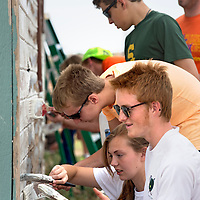 071013  Adron Gardner/Independent<br /> <br /> Youth Works volunteers from Alaska paint a house in Fort Defiance Wednesday.